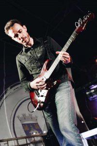 Pedro Almeida Rocking the Guitar in Concert
