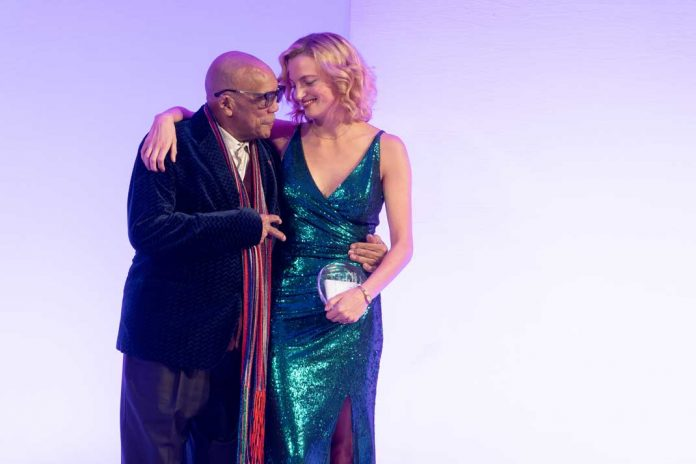 Quincy Jones presents the Q-Award to Amanda Booth at Global's 2019 Be Beautiful Be Yourself Fashion Show